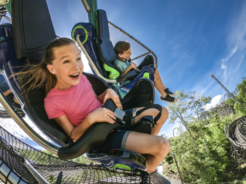 One of the feature ride attractions in Wildwood Grove, Dragonflier is a suspended roller coaster that allows guests to soar like a dragonfly, dipping and darting along the gushing geysers and lush landscape of Dollywood's newest area. (Photo: Business Wire)