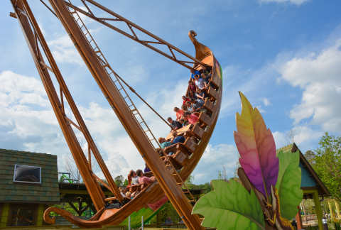 Guests aboard the Great Tree Swing rock back and forth just like a leaf falling from a giant sycamore tree. The Great Tree Swing is one of the new attractions in Dollywood's Wildwood Grove. (Photo: Business Wire)