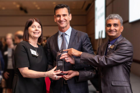 Jeff Aronin receives Northern Illinois University's 2019 Innovation and Entrepreneurship Award, presented by Dr. Lisa Freeman, President of NIU, and Dr. Balaji Rajagopalan, Dean of the College of Business. (Photo: Business Wire)