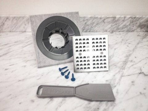 At the center of the system is the GoBoard Point Drain kit, which includes the universal drain cover assembly and pre-assembled drain body with integrated membrane. (Photo: Business Wire)