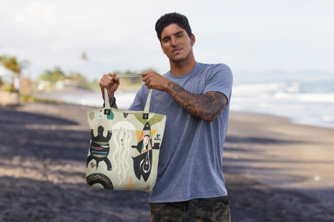 Gabriel Medina and the limited-edition, reusable bag he designed to support the ban of single-use plastic in Bali. (Photo: Business Wire)