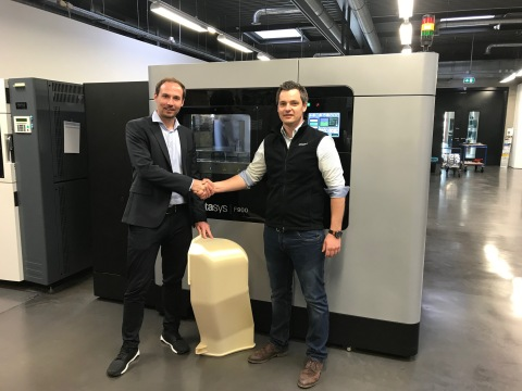 André Bialoscek Head of Vehicle Physical Integration Hennigsdorf, Bombardier, holding a 3D printed Air Duct, and Dominik Mueller, Strategic Account Manager at Stratasys (Photo: Business Wire)