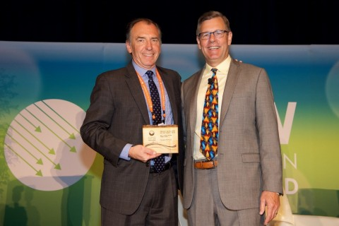 Dick Kempka, Molpus Woodlands Group's Vice President – Conservation accepts the Developer of the Yea ...