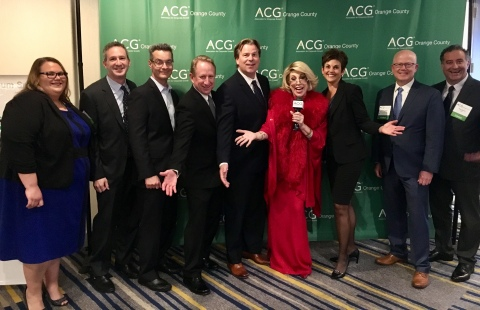 "The NTS executive team poses with ""Joan Rivers"" to celebrate the nomination in the ACG Global Growth category. (Photo: Business Wire)"