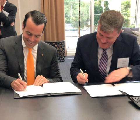 Brian Neff, Sintavia's Founder and CEO and David Preston, Executive Vice President at Howco Group, sign a term sheet to form a joint venture in support of the development of additive manufacturing within the Oil & Gas industry. (Photo: Business Wire)