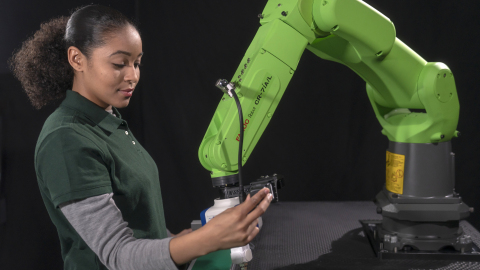 FANUC's Hand Guidance feature allows operators to easily teach a collaborative robot. (Photo: Busine ...