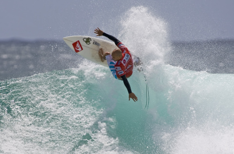 Kelly Slater competes at Quiksilver Pro Gold Coast, World Surf League, 2010 (Photo credit: Surfglass ...