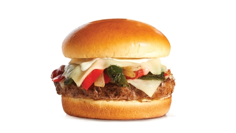 New Loaded Philly Steakburger from IHOP is piled high with sautéed onions and peppers and smothered with melted White Cheddar cheese and Cheddar cheese sauce. (Photo: Business Wire)