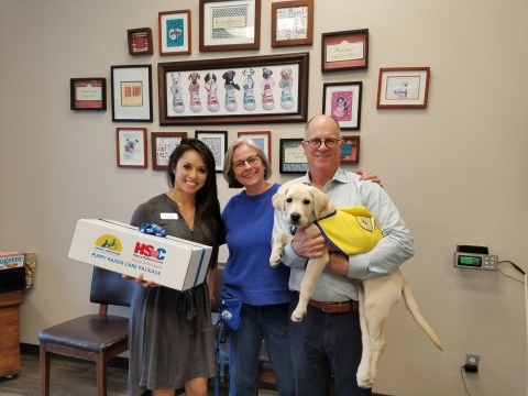 (From left to right): Covetrus representative Uyen Ta presents 2,000th Covetrus Puppy Care Package t ...