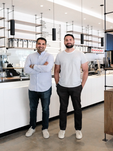 For Five Coffee founders Stefanos Vouvoudakis and Tom Tsiplakos stand inside the new 1 Liberty Plaza cafe a few days prior to opening. (Photo: Business Wire)