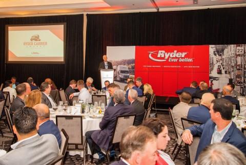 Vice President & General Manager of Ryder Transportation Management Dave Belter addresses packed hou ...