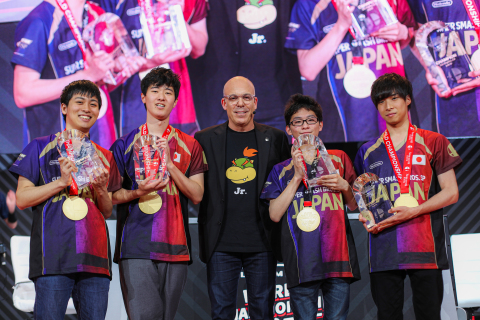 In this photo provided by Nintendo of America, Doug Bowser, President of Nintendo of America, congratulates Team Japan, winner of the Super Smash Bros. Ultimate World Championship 2019 3x3 on Saturday, June 8, 2019, at the Theatre at the Ace Hotel in Los Angeles. (Photo: Business Wire)