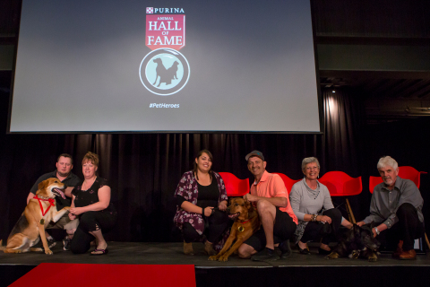 Jason Chafe and Rachel Spiewak with Tucker, Brittany and Bryan Ouellette with Rosco and Louise Robillard and Andy Chyc with Shelby, accepting their medals of honour at the 51st Purina Animal Hall of Fame ceremony. (Photo: Business Wire)