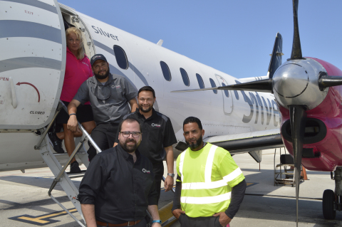 Silver Airways' new uniforms capture the airline's professional friendly character with style and comfort, and incorporate the airline's signature turbine logo and fuchsia, black and grey colors. (Photo: Business Wire)