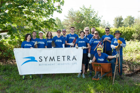 "Symetra CEO Margaret Meister (fifth from left) joined a team of employees during a 2019 Symetra Week of Service project. The volunteers helped clear the CKC Trail in Kirkland, Wash., of invasive species as part of the national life insurer's 11th annual week of community service. ""We are proud to support our employees' volunteer spirit during Symetra Week of Service and throughout the year. As individuals, our employees are empowered to give back to the causes and organizations that matter to them personally through hands-on service opportunities like this. Every year, we all look forward to this powerful expression of Symetra's 'Swift to Serve' core value as we come together on behalf of our communities,"" said Ms. Meister. (Photo: Business Wire)"