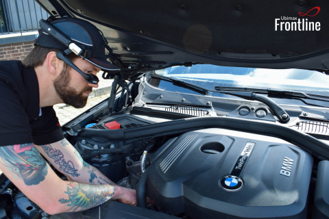 BMW mechanic using Ubimax software wearing the RealWear HMT-1 hands-free wearable computer to speed repairs by up to 75%. (Photo: Business Wire)