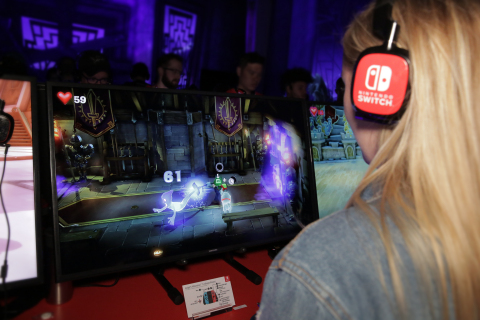 In this photo provided by Nintendo of America, a visitor to the atmospheric Luigi's Mansion 3 section of the Nintendo booth on June 11, 2019, at the E3 video game conference in Los Angeles captures a ghost using Luigi's upgraded Poltergust G-00 accessory. Luigi's Mansion 3 launches exclusively for Nintendo Switch in 2019. (Photo: Business Wire)