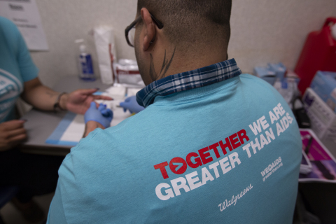 Member of a local testing organization performing an on-site free and fast HIV test (Photo: Business Wire)