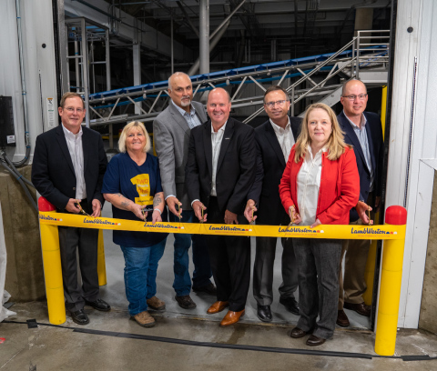 Lamb Weston employees closed the ceremony with a ribbon cutting.  Shown left to right: Rick Martin, Chief Supply Chain Officer; Leslie Winker, 45 year tenured employee; Neal Flyg, Hermiston Plant Manager; Tom Werner, President & CEO; Wayne Claver, Senior Director of Manufacturing; Carol Samoray, Vertical Stand-up Manager; and Brian Jackson, Engineering Manager. (Photo: Lamb Weston)