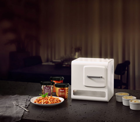 Introducing Genie, the world's only compact, automated cooking system in a small footprint (that is the size of a home coffee machine) that can cook delicious and nutritious meals with the push of a button. Serving Traditional Penne Bolognese. (Photo: Business Wire)