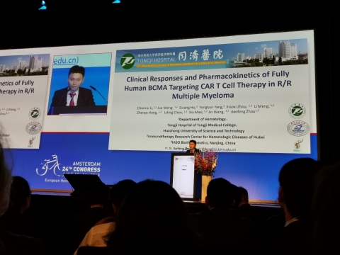 """Dr. Jue Wang of Tongji Hospital of Tongji Medical College, Huazhong University of Science and Technology, presents the latest data on CT103A at the """"Immunotherapy in Relapsed/Refractory Multiple Myeloma"""" session during the EHA Annual Meeting 2019 in Amsterdam, Netherlands. (Abstract#S827) (Photo: Business Wire)"""