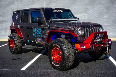 This Jeep was custom designed by Tommy Pike Customs in partnership with ARIES and features a 3.6-liter V6 engine, and 8-speed automatic transmission, and a full military-themed vehicle vinyl wrap with graphics and more. 100% of the hammer price of this jeep will benefit NS2 Serves, a non-profit that prepares veterans for jobs in high-tech. Bid on this vehicle and others at www.proxibid.com/barrettjackson (Photo: Barrett-Jackson).