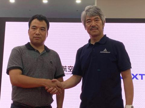 From photo right, Aeronext Inc. President/CEO Keisuke Toji, MMC CEO Zhihui Lu (Photo: Business Wire)
