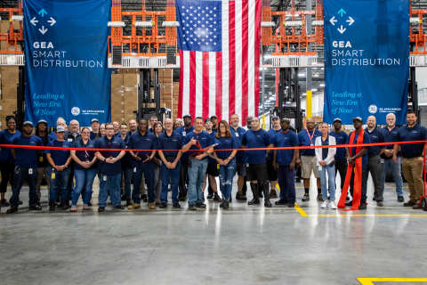 New employees at GE Appliances' new smart warehouse in Commerce, Georgia – representing some of the 100 new jobs created for the facility – prepare to cut the ribbon and celebrate the opening of the location. (Photo: GE Appliances, a Haier company)