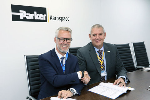 Contract signing between Austin Major, Parker Aerospace Customer Support Operations (CSO), and Gery Mortreux, Air France Industries KLM Engineering & Maintenance. (Photo: Business Wire)