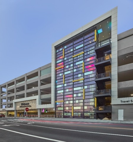 """(Cesar Rubio Photos) The lighting installation in the long-term parking garage at San Francisco International Airport, designed by artist Johanna Grawunder (https://www.grawunder.com), titled Coding, uses a range of Traxon lighting technologies to create a subtle light show that is visible throughout the day and night, and uses the building's existing steel beams and mirrored windows to suggest dots and dashes, ultimately spelling """"San Francisco"""" in Morse code."""