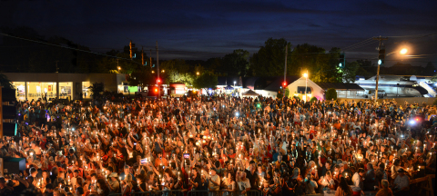 Tens of thousands of people attend the Elvis Week Candlelight Vigil every year. (Photo: Business Wire)
