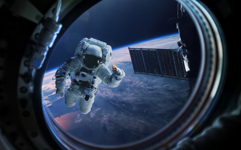 Window View of Astronaut Holding DoubleTree Cookie (Photo: Business Wire)