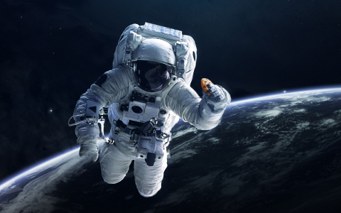 Astronaut Holding DoubleTree Cookie (Photo: Business Wire)