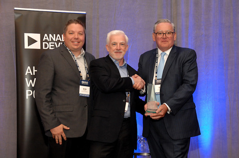 National Instruments CEO Alex Davern (pictured center) accepts the Supplier of the Year Award from John Hassett, Senior Vice President Global Operations and Technology at Analog Devices. Pictured on the left is Kevin Bisking, Global Account Manager for National Instruments. (Photo: Business Wire)