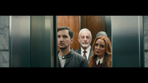 """""""The Look"""" follows a Black man throughout his day as he encounters a variety of 'looks' that symbolize a barrier to acceptance. In the film, occupants of an elevator seem to shut him out as he approaches. (Photo: Business Wire)"""