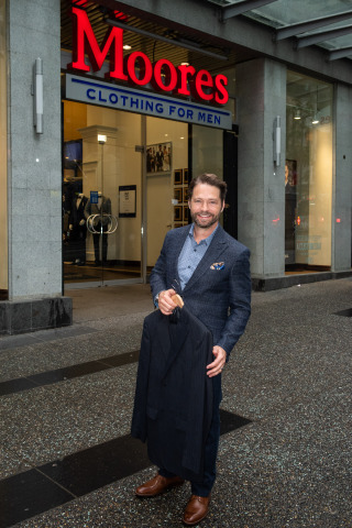 Canadian actor and director Jason Priestley makes the first donation to Moores Clothing for Men's 10th Annual Suit Drive at the retailer's downtown Vancouver store. Starting July 1 to 31, Canadians can donate gently-worn professional clothing at 126 Moores stores nationally. The national cause helps disadvantaged individuals feel confident and look their best on job interviews in effort to change their lives by entering the workforce. (Photo: Business Wire)