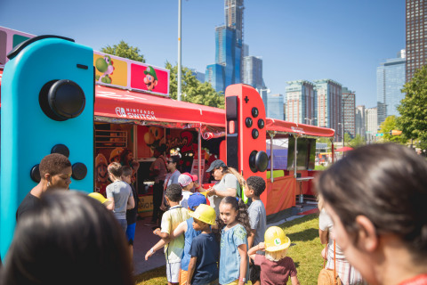In this photo provided by Nintendo of America, members of the Chicago Children's Museum kick off the nationwide Nintendo Switch Road Trip at Navy Pier in Chicago on June 27, 2019. The event allowed attendees to play a variety of Nintendo Switch games, including the Super Mario Maker 2 game a day before its June 28 launch. Super Mario Maker 2 gives players the tools to play, create and share side-scrolling Super Mario courses. The tour continues across the country through mid-October. (Photo: Business Wire)