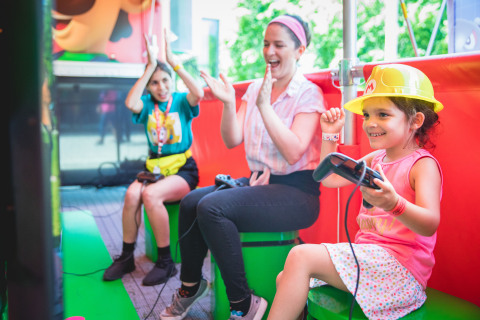 In this photo provided by Nintendo of America, Chicagoans Carly A. and her daughter, Ariel, 6, play the Splatoon 2 game for Nintendo Switch at the kickoff event for the nationwide Nintendo Switch Road Trip at Navy Pier in Chicago on June 27, 2019. The event allowed attendees to play a variety of Nintendo Switch games, including the Super Mario Maker 2 game a day before its June 28 launch. Super Mario Maker 2 gives players the tools to play, create and share side-scrolling Super Mario courses. The tour continues across the country through mid-October. (Photo: Business Wire)