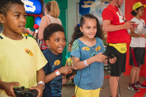 In this photo provided by Nintendo of America, brothers Xavier H., 9, and Max H., 7, of Chicago join Tandy T., 7, of Chicago in a game of Super Mario Party. As members of the Chicago Children's Museum, the trio helped kick off the nationwide Nintendo Switch Road Trip at Navy Pier in Chicago on June 27, 2019. The event also allowed attendees to play the Super Mario Maker 2 game a day before its June 28 launch. Super Mario Maker 2 gives players the tools to play, create and share side-scrolling Super Mario courses. The tour continues across the country through mid-October. (Photo: Business Wire)