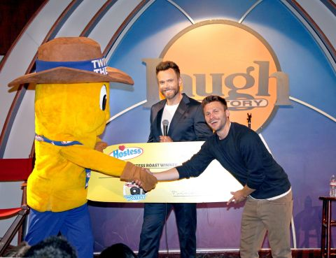 Hostess Roast master of ceremonies Joel McHale and Twinkie the Kid present Jon Rudnitsky with a $10,000 check after he was declared winner of the Hostess Roast. Rudnitsky took the stage along with fellow comedians Erica Rhodes, Johnny Sanchez, Harland Williams, Finesse Mitchell and Mary Lynn in front of an audience of fans who gathered at the Laugh Factory on June 25th.