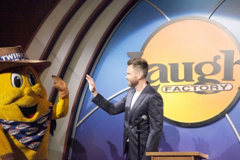 Joel McHale, who served as master of ceremonies at the Hostess Roast, goes in for a high-five with Twinkie the Kid. As part of Hostess's 100th birthday, comedians Erica Rhodes, Johnny Sanchez, Harland Williams, Finesse Mitchell, Mary Lynn Rajskub and Jon Rudnitsky competed for a $10,000 prize in front of an audience of fans who gathered at the Laugh Factory on June 25th.