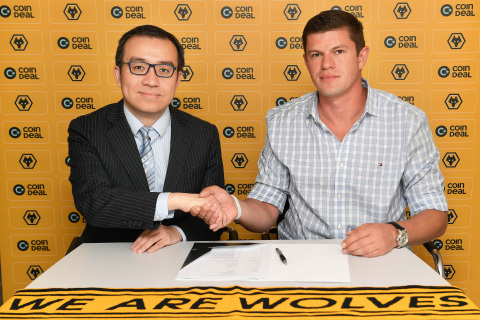Jeff Shi (Executive Chairman Wolverhampton Wanderers) and Kajetan Máckowiak (Co-founder CoinDeal) (Photo: Business Wire)
