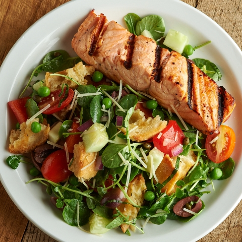 Aramark and the American Heart Association are kicking summer grilling into high gear by sharing a list of heart-healthy recipes and inspiring people to give new plant-forward menus a try this summer, like this Grilled Salmon & Panzanella Salad. (Photo: Business Wire)