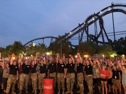 Members of the 135th Army band Aftershock toast America at Six Flags St. Louis during the annual Coca-Cola July 4th Fest. (Photo: Business Wire)