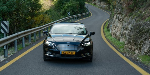 A photo shows a Ford Fusion that has been fitted with Mobileye autonomous vehicle technology. Mobileye, an Intel company, is the leader in assisted driving and a pioneer in the use of computer vision technology. The company, based in Jerusalem, became part of Intel in 2017. (Credit: Mobileye)