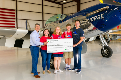 """Southeastern Grocers announces more than $1.2 million donation to Folds of Honor on behalf of generous customer and associate donations during the grocer's six-week """"round up"""" community donation program. (From left to right) Eddie Garcia, EVP of Store Growth for Southeastern Grocers; Chloe, Leanne and Wyatt McCain, Folds of Honor family and scholarship recipients; Ben Leslie, Executive Vice President of Folds of Honor. (Photo: Business Wire)"""