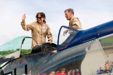 Melissa Marlin (left) returns from a once-in-a-lifetime orientation flight in the legendary Crazy Horse 2, a P-51 Mustang, which she won for her efforts to encourage the most donations from customers throughout all BI-LO, Harveys and Winn-Dixie stores in the Southeast. (Photo: Business Wire)