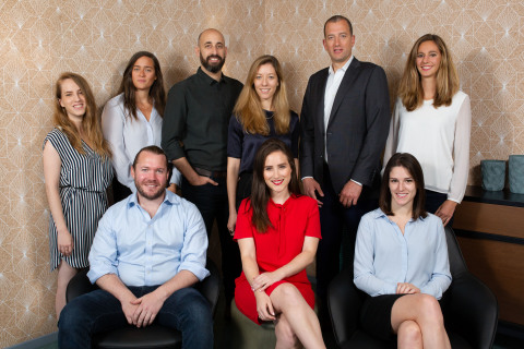 Standing from left: Analyst Naama Ben Dov, Office Manager Gye Cohen, Partner & Head of Israeli Office Ofer Schreiber, VP of Marketing Sharon Seemann, Managing Partner Yoav Leitersdorf and Analyst Zsofia Boros. Seated from left: Partner John Brennan, Marketing Specialist Dana Harel and Intern Ainhoa Maiz. (Photo: Business Wire)