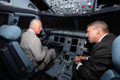 His Royal Highness The Prince of Wales flies an L3Harris RealitySeven A320 Full Flight Simulator with Robin Glover-Faure, President of L3Harris Commercial Training Solutions. (Photo: Business Wire)