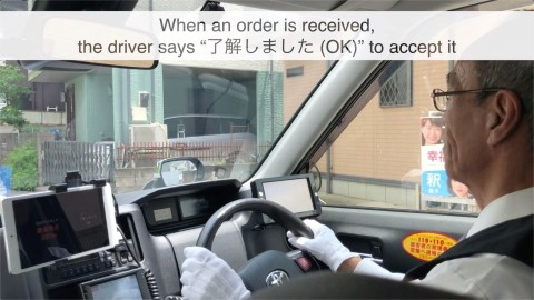 One Japanese taxi driver demonstrates the hands-free pickup feature. (Photo: Business Wire)